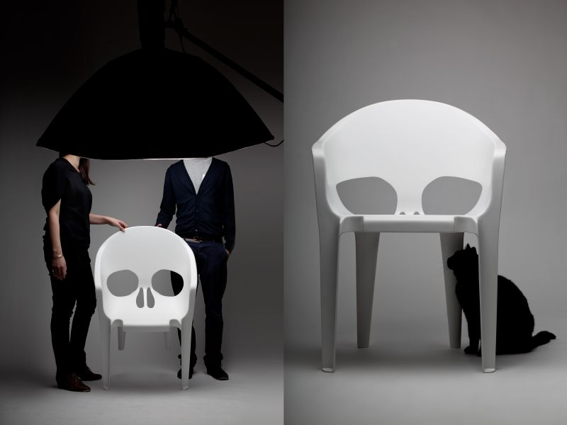 White fiberglass skull chair by pool