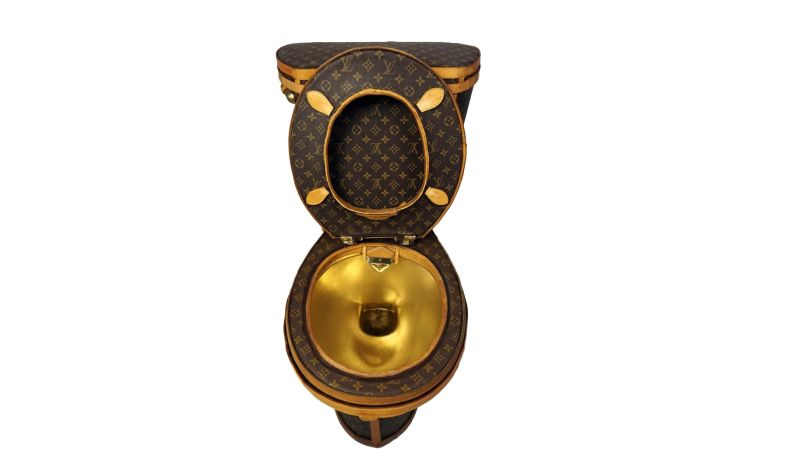 Loo-uis Vuitton golden toilet by Illma Gore is up for sale at Tradesy for $100,000