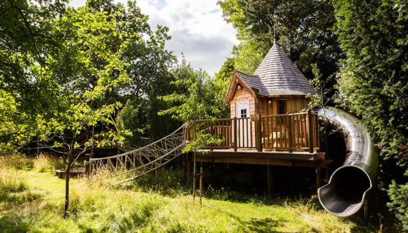 blue forest s fairytale treehouse complete with its own slide