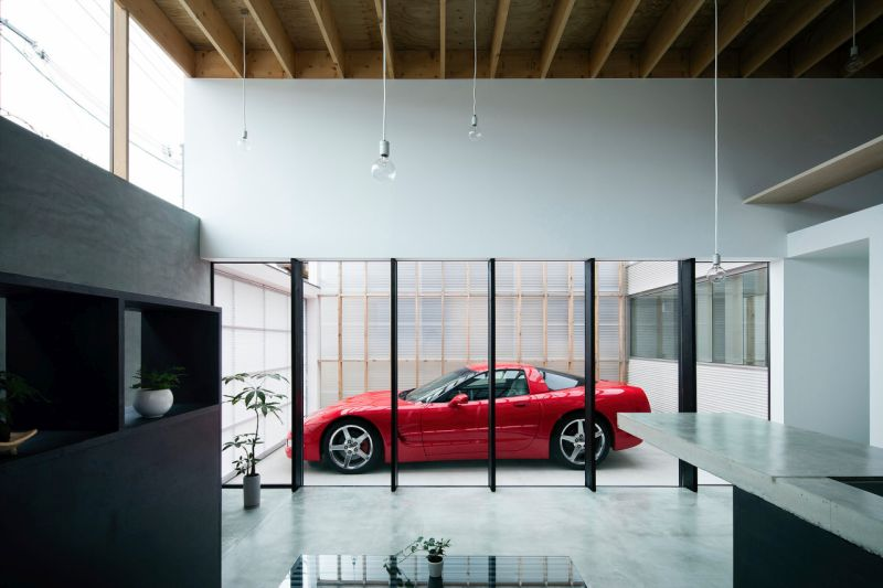 Sleeping Right Next To Your Supercar Inspiring Homes With Living Room Parking