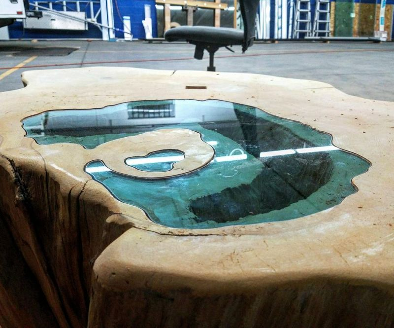 lake coffee table from a 400-year-old tree trunk 23
