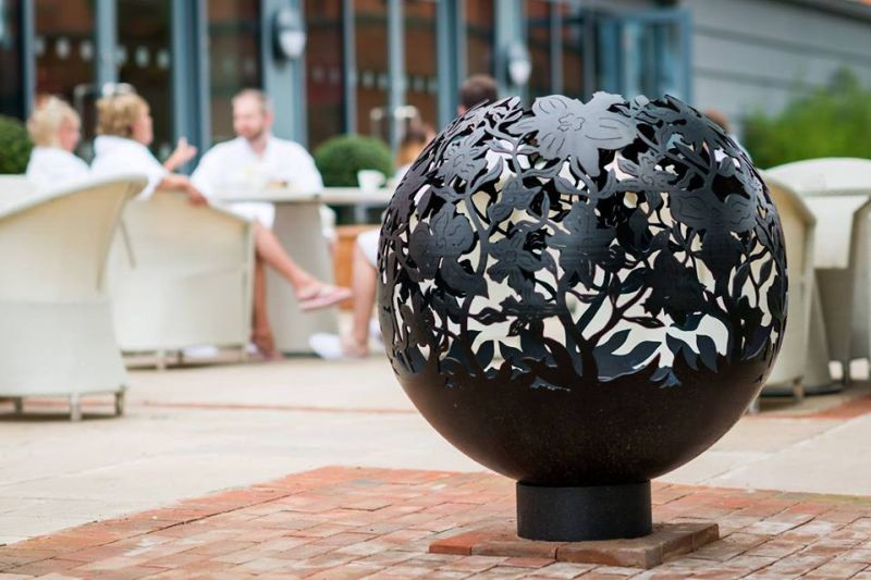 Andy Gage carves intricate designs on metal fire pits
