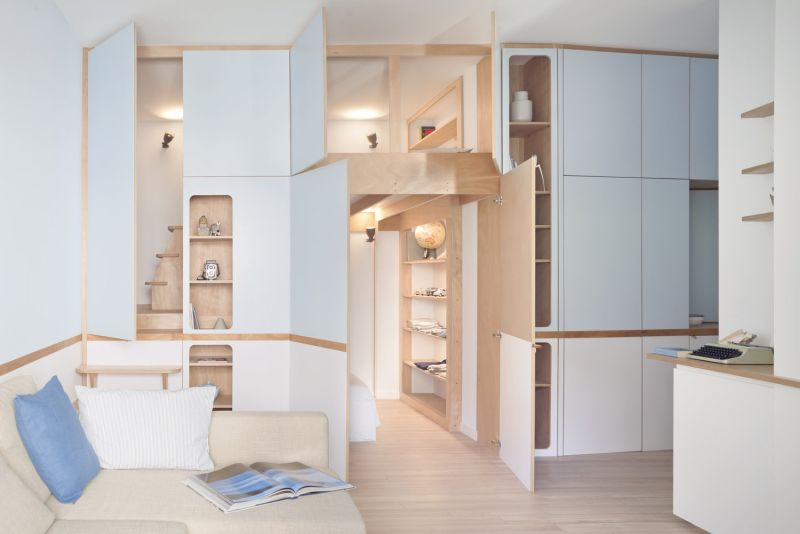 Rivera Cabin: A Custom Wall Unit that Makes this Apartment Look Spacious