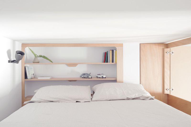 Rivera Cabin: A Custom Wall Unit that Makes this Apartment Look Spacious