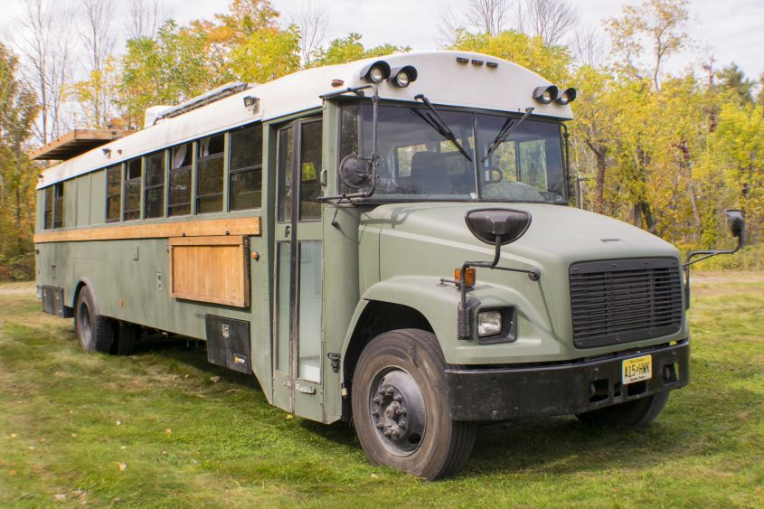 This converted school bus home with rooftop deck is perfect for life on the road
