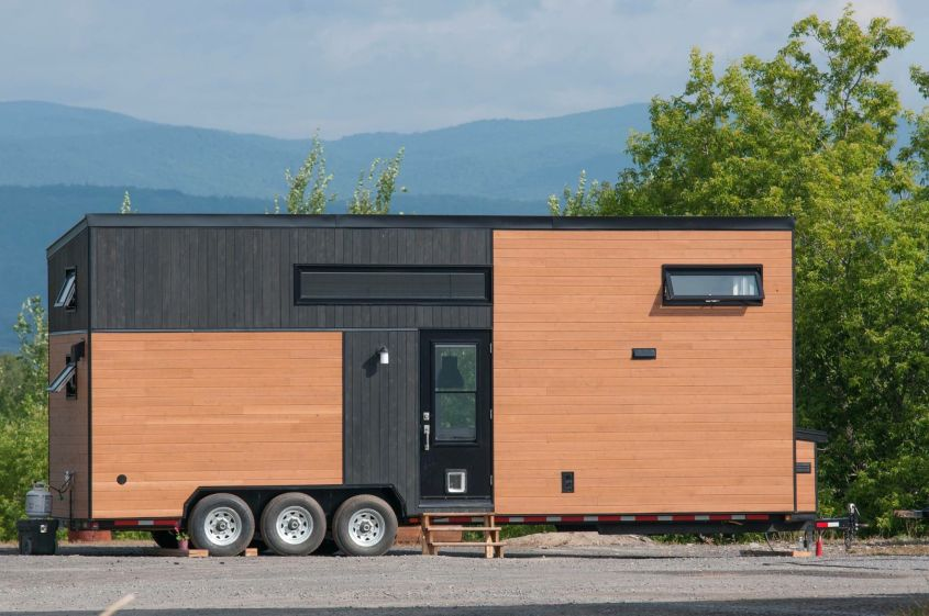 Eucalyptus tiny house on wheels This tiny house inspired by Californian style is built by Quebec tiny house builder Minimaliste. From material and interior design to furniture and appliances, all important design elements are decided by customers. An off-grid system of 2kW is used to fulfill power requirements.