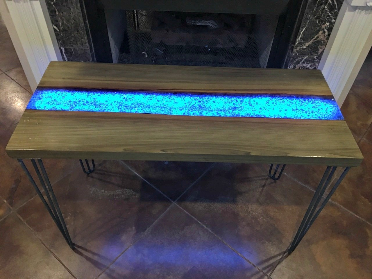 this live edge river table glows in the dark adding life to your interiors. Black Bedroom Furniture Sets. Home Design Ideas