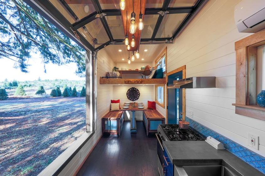 Tiny house on wheels with climbing wall