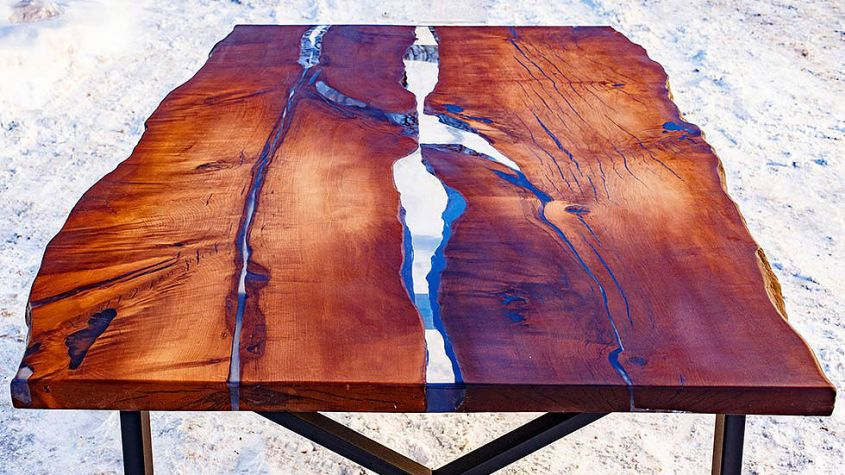 Hard Massive's live edge dining table with epoxy resin inlay to look like river