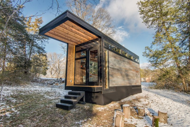Cornelia Is A Writer's Cabin Featuring Folding Desk With A