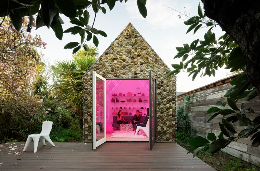 This 3D-Printed Cabin features a Living Wall of Succulents