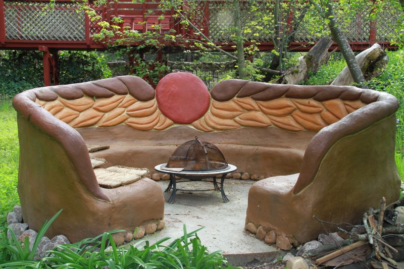 Miguel Elliott's (Sir Cobalot) Creates cob houses and outdoor bench