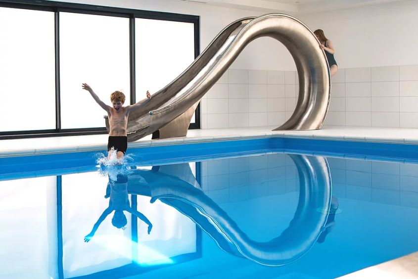 Waha Residential Water Slide from SplinterWorks Fits into Existing Pools