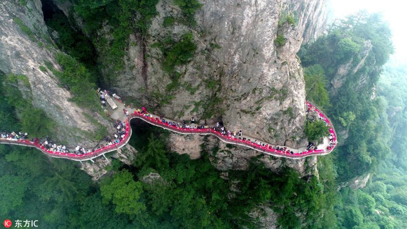 The feast in the sea of clouds on a Narrow Cliffside Pathway in China