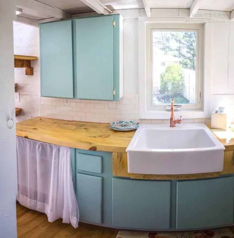 TAD Homes' Tiny House on Wheels with Garage Door