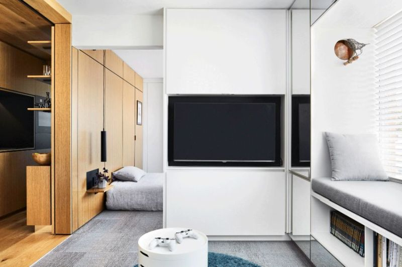 tsai design apartment hides bedroom behind sliding walls-Apartment living- Living Room area