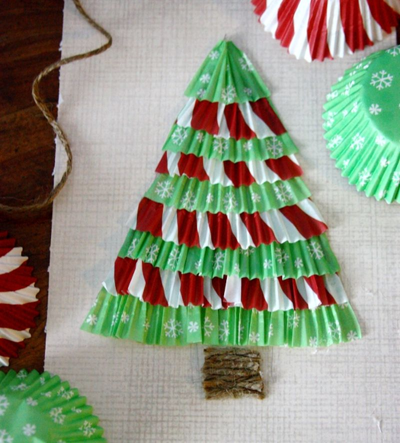 Cupcake Liner Christmas Trees A simple alternative Christmas tree centerpiece that can be prepared easily using cupcake wrappers. It is ideal to use different colors of cupcake liners. The base can also be prepared to give it a more elegant look. You can place them on a table or on a mount on a wall.