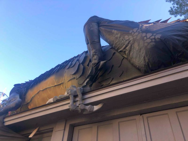 Dragon Halloween Decorations.There S A Gigantic Dragon Crawling On This Home S Roof