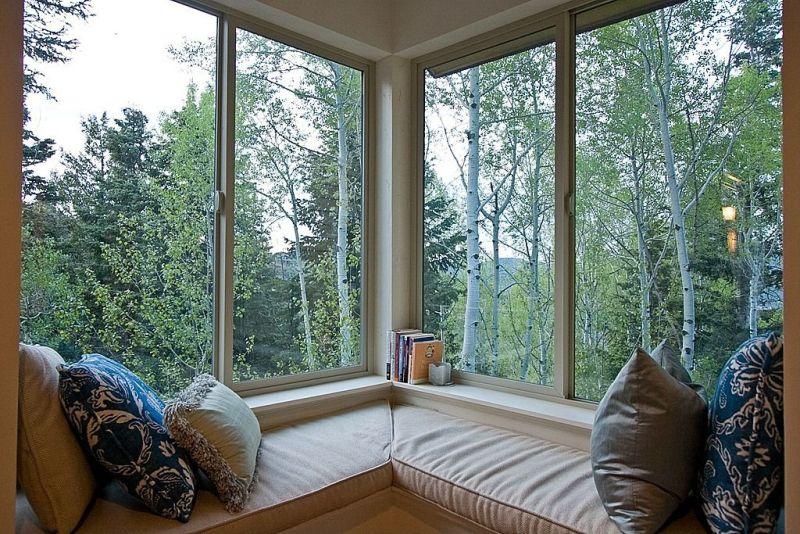 Modern corner windows with seating