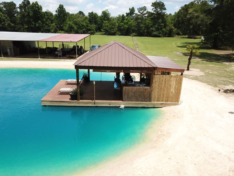 Zydeco Construction can Make A Beach-Like Swimming Pond in Your Backyard
