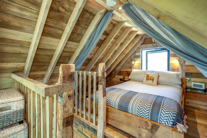 Cadwollen's Treehouse is one of the vacation rentals available at the Squirrel's Nest Treehouse retreat located on a working family farm in Powys, Mid Wales, UK.