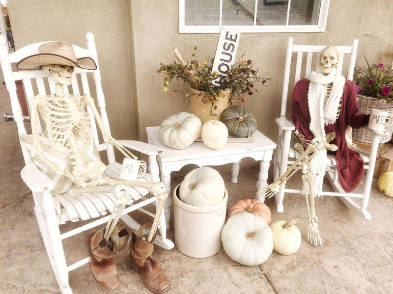 Skeleton couple sitting in the front porch