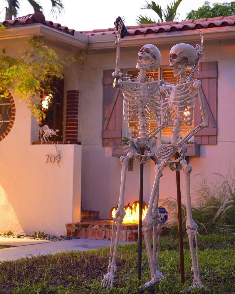 Skeleton couple taking a selfie