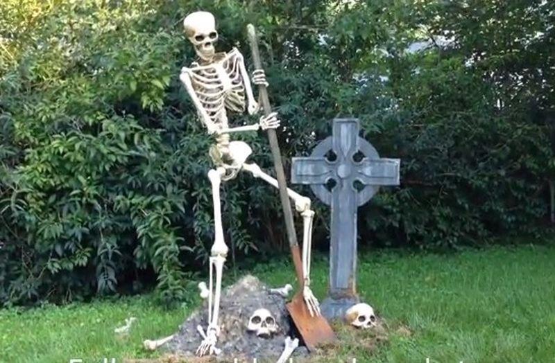 Skeleton digging a grave