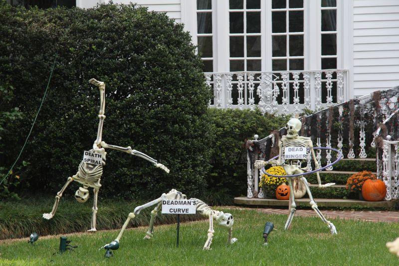 Skeleton gymnasts in yard
