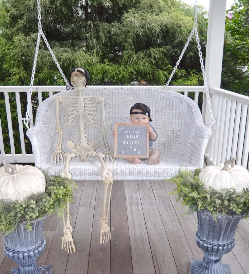 Skeleton on a swing in porch