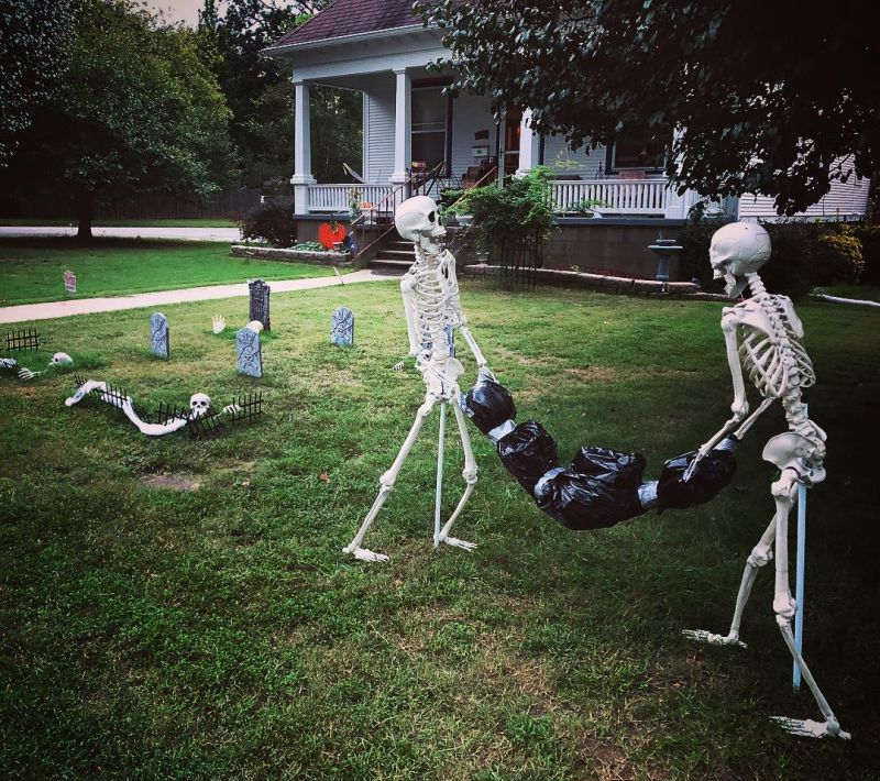 Skeletons dumping a body in flowerbeds