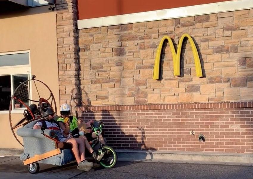 Crazy Guys Travel to McDonald's in a Paramotor Sofa