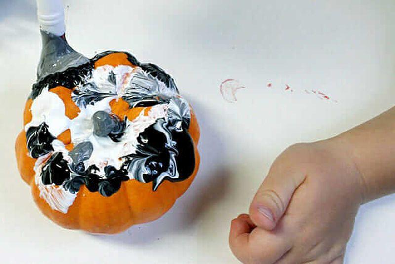 Painting pumpkins Halloween activity for kids