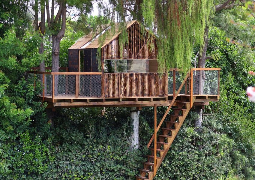 This Backyard Treehouse for Kids has Charred Wood Exteriors