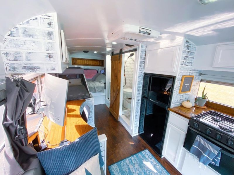 Couple Travels Full-Time in Converted Bus Home with Baby Girl and Dog