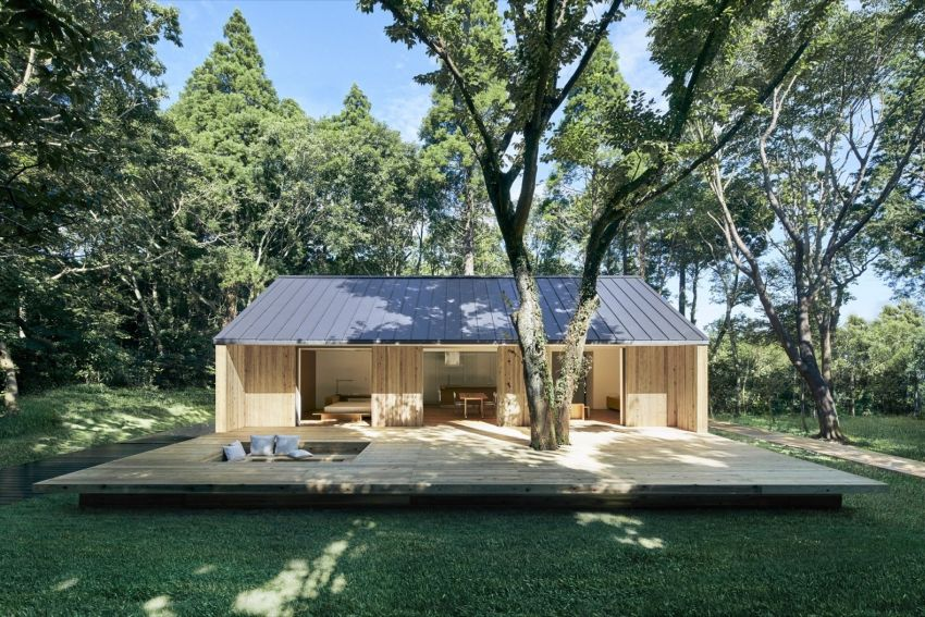 Muji's Latest Prefab House Features Large Outdoor Deck with Sunken Seating & Fireplace