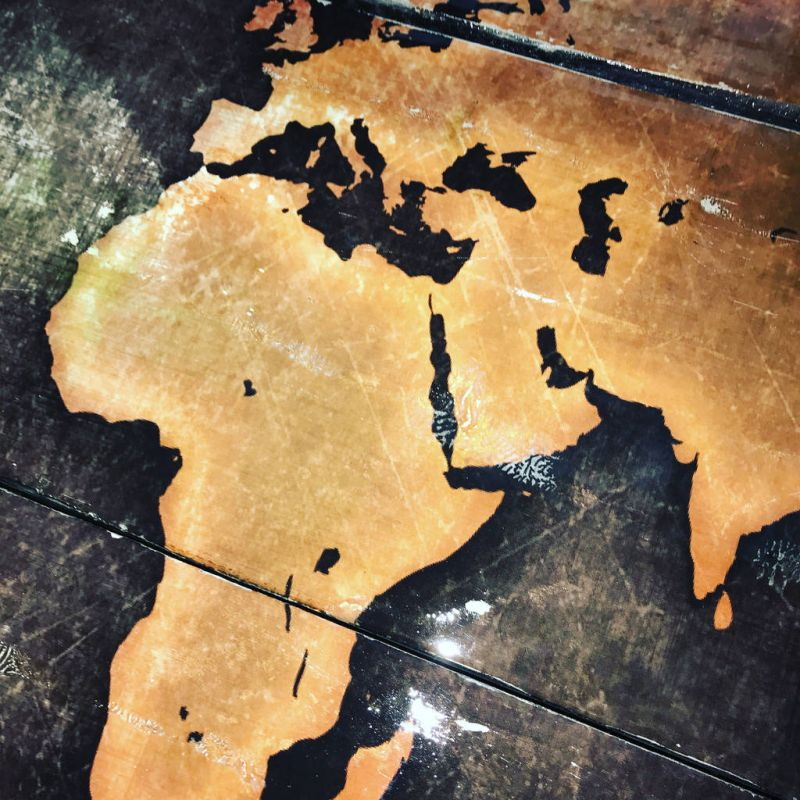 Take Home this Vintage World Map Coffee Table for $1k