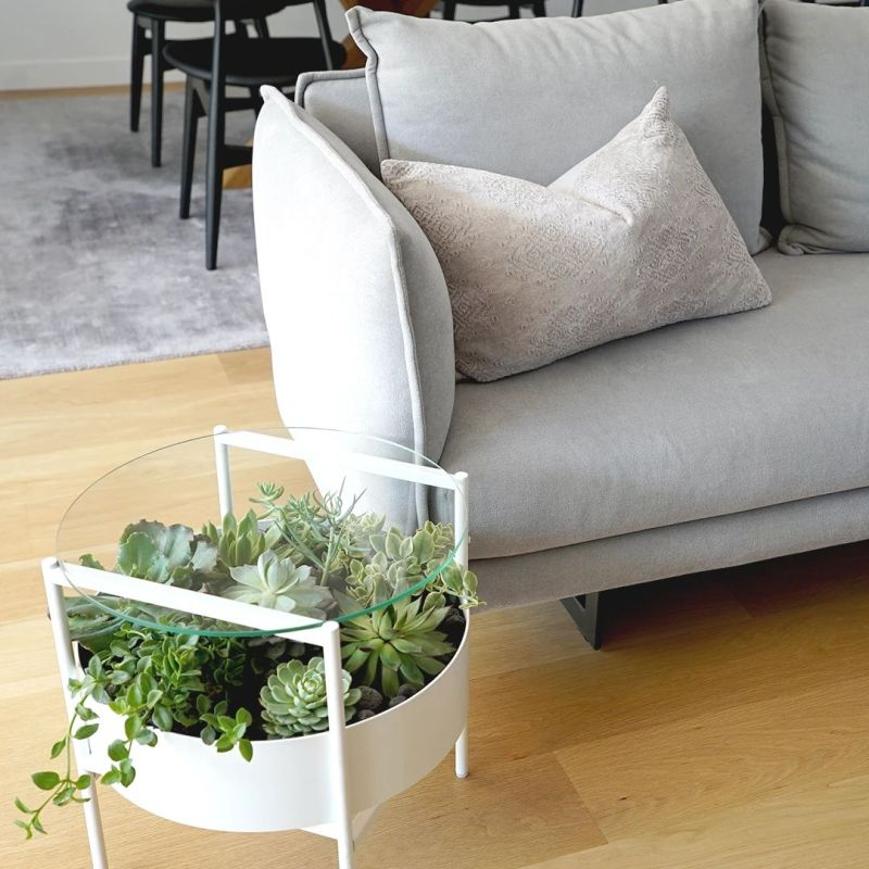 Palm Urban's Green Glass Table has Built-in Planter